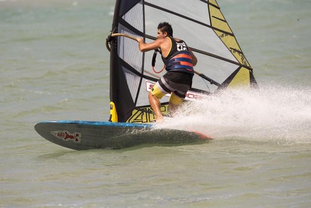 Kurosh Kiani windsurfing on Maui Hawaii carving the board through a gybe